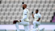 Message: Roston Chase of the West Indies takes a knee