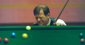 Master at work: Alex Higgins eyes up the table