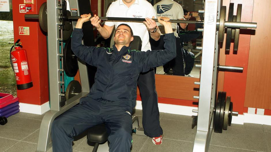 Mark helping then Northern Ireland international David Healy in his health club at the Hilton, Templepatrick