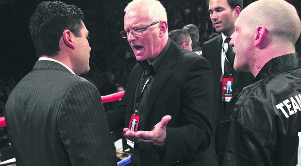MANCHESTER, ENGLAND - APRIL 16: Barry Hearn the promoter of Paul McCloskey argues with Oscar de la Hoya after the WBA Light-Welterweight Championship fight between Amir Khan and Paul McCloskey at MEN Arena on April 16, 2011 in Manchester, England. (Photo by Alex Livesey/Getty Images)