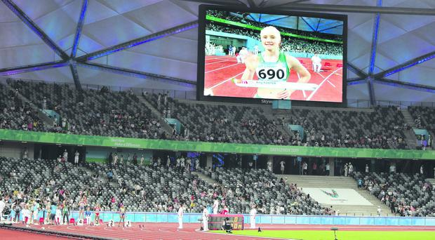 Amy Foster is presented to the crowd at the World University Games in Shenzhen in 2011