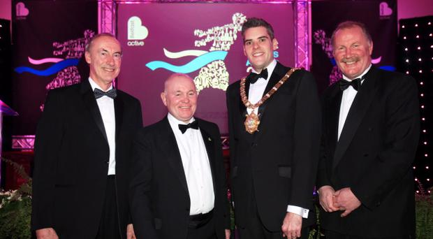Derek Graham, Davy Larmour and Billy Hamilton with Lord Mayor Gavin Robinson at City Hall last night