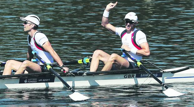 Adam Freeman-Pask (L) and Richard Chambers (R) of Great Britain celebrate winning the Men's Lightweight Double Sculls Final during day 3 of the 2013 Samsung World Cup at Sydney International Rowing Centre on March 24, 2013 in Sydney, Australia. (Photo by Matt King/Getty Images)
