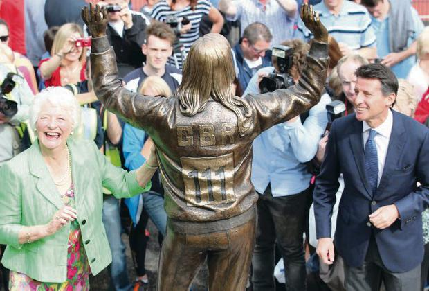 Dame Mary Peters and Lord Coe get the first glimpse of the new statue