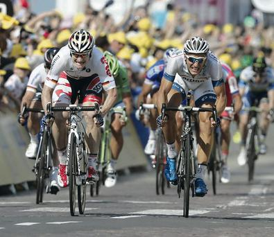 Marcel Kittel of Germany, center right, crosses the finish line ahead of second place Andre Greipel of Germany, center left, to win the tenth stage of the Tour de France.