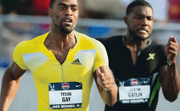 Tyson Gay (left) sprints past Justin Gatland at last month's US Outdoor Track & Field finals