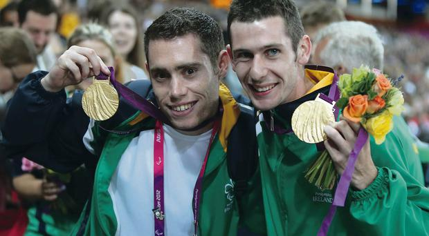 Happier days: Jason Smyth (left) and Michael McKillop show off their gold medals in London last year