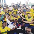 Injection of colour: The Brazil football team celebrate victory in typical style at the World Police and Fire Games