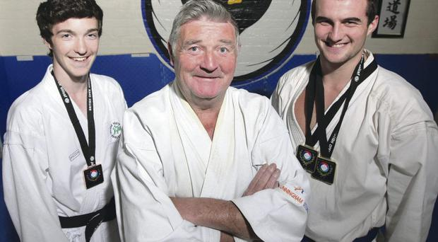 Champion: James Brunton, right, with his father Oliver and Craig Ryan, the junior bronze medallist