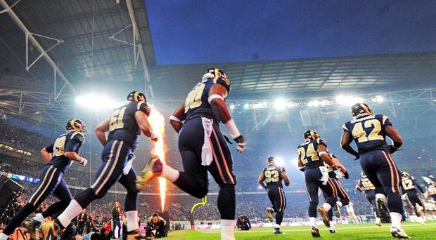 The St Louis Rams players make their entrance at Wembley on Sunday