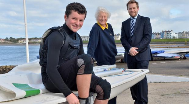 Liam Glynn, who has just been crowned the Topper sailing class world champion, received a Rainbow Communications Sports Award in partnership with the Mary Peters Trust. Joining Liam is Dame Mary Peters and Stuart Carson, sales and marketing director at Rainbow Communications