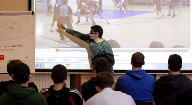 Josep Maria Berracol commands the full attention of his Belfast Star players during a pre-season tactical meeting