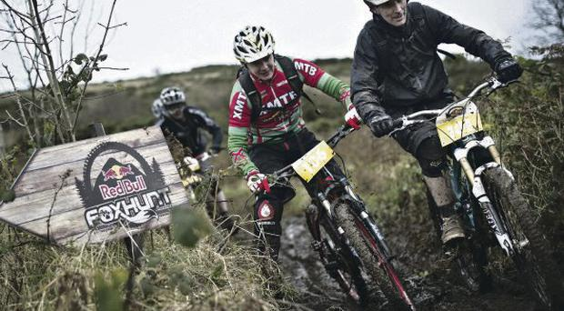Mountain to climb: Riders battle it out in last year's Red Bull Fox Hunt in Cave Hill Country Park, Belfast