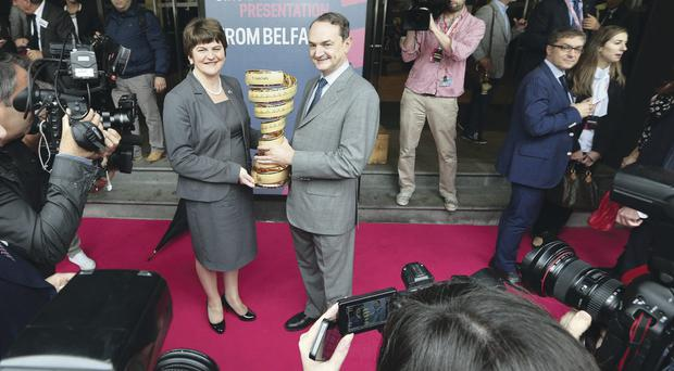 Big wheels: Minister Arlene Foster with race chief Riccardo Taranto at the Milan launch yesterday