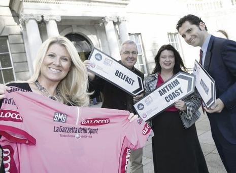 Think pink: Fiona Cunningham from Northern Ireland Tourist Board joins legendary Irish cyclist and former Giro winner Stephen Roche, Naomi Waite from NITB and Giovanni Nipoti from RCS Sport as they gear up for next year's Giro d'Italia cycle race Belfast start