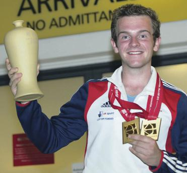 Top of the class: Belfast's Patrick Huston shows off the two gold medals he fought hard to win in China