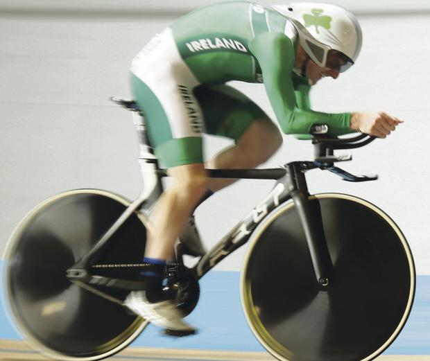 Hot wheels: Martyn Irvine in action in Holland, where he claimed a bronze medal in the men's Omnium event