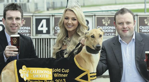 Lady luck: Miss Northern Ireland Meagan Green with (left) Paul McGurk, innovation marketing manager with Tennent's NI, and John Connor, Drumbo Park racing manager, at yesterday's launch of the Caledonia Smooth Gold Cup at Drumbo Park