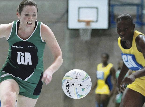 Northern Ireland's Oonagh McCullough battles with Jeneice Clarke of Barbados yesterday at the Antrim Forum