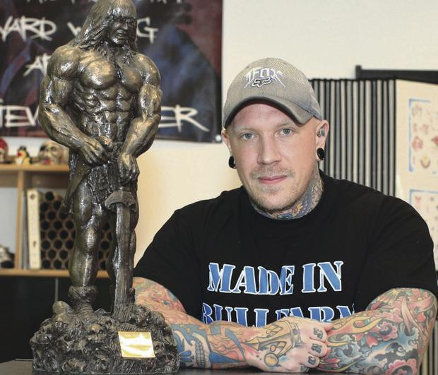 Andrew Cusick has risen to the top in powerlifting despite breaking his back in a motocross accident