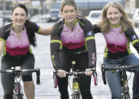 Taryn McCoy (left), Julie McCorry and Andrea Harrower (right), with team-mate Cathy Booth, fit their love of cycling around busy lives