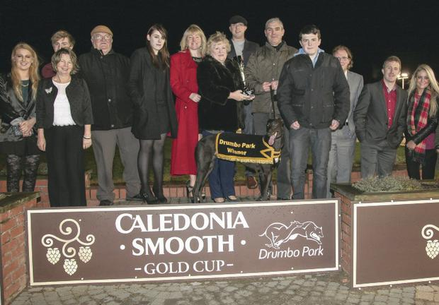 Mrs Catherine Connolly presents the Robert Connolly Memorial trophy to Philip McCormick, owner of race winner Champagne Ash at Drumbo on Saturday night