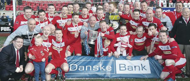 Cliftonville celebrate their league success in 2013