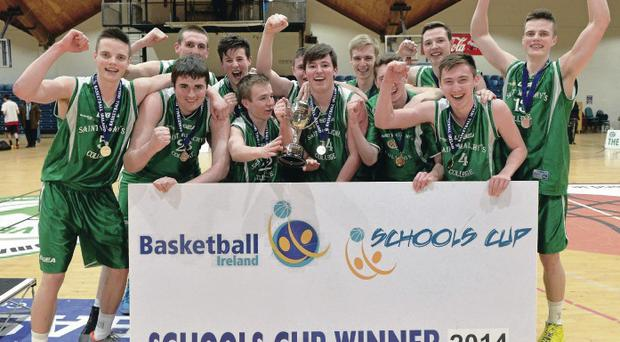 St Malachy's celebrate securing the All-Ireland Schools Cup yesterday after a thumping 80-58 win over Bray