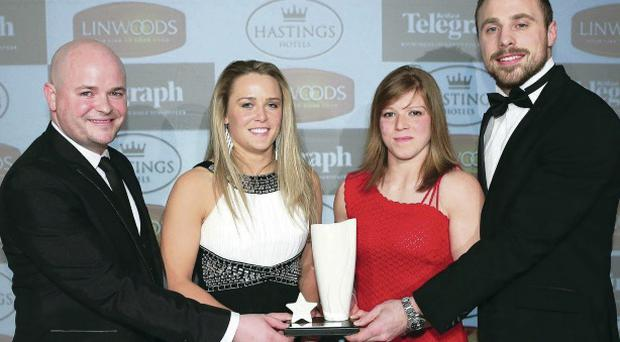 Ireland rugby players Ashleigh Baxter and Amy Davis at the Belfast Telegraph Sports Awards with Neil Devlin of Hastings Hotels and Ulster and Ireland star Tommy Bowe