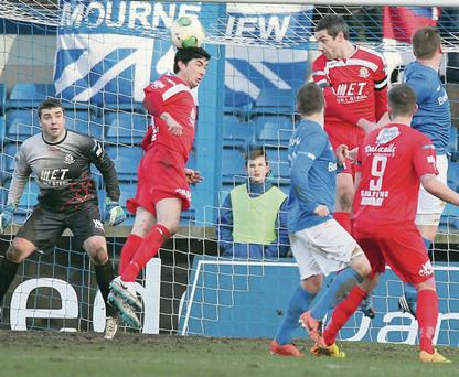 Portadown's Emmett Friars gets up to clear his lines