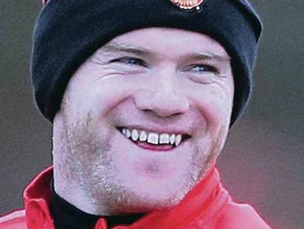 Manchester United's Wayne Rooney all smiles during the training session at the AON Training Complex, Manchester