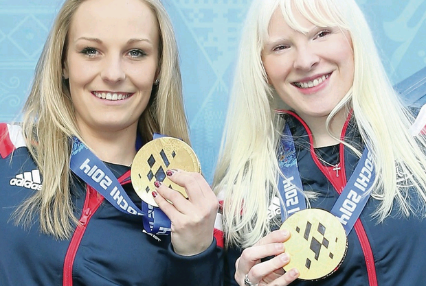 Golden girls: Kelly Gallagher (right) and guide Charlotte Evans show off their Paralympic medals