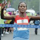 Bayush Adebe Shiferaw crosses the line first in the women's race yesterday