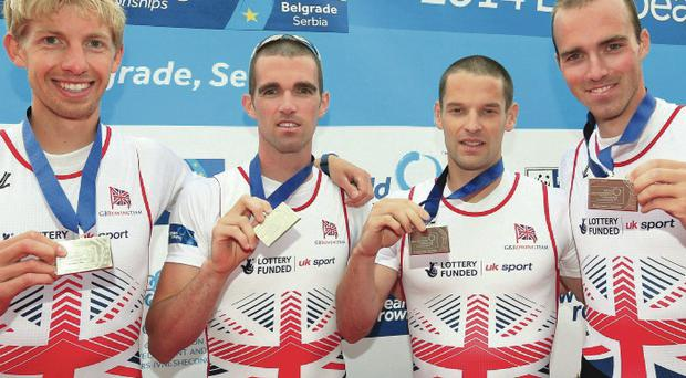 Silver lining: Peter and Richard Chambers, flanked by Mark Aldred and Chris Bartley, show off their medals in the lightweight fours