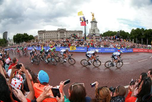 London calling: Tour de France third stage race leaders pass the Victoria Memorial and Buckingham Palace on their way to a sprint finish on The Mall. German Marcel Kittel, who also won on Saturday, crossed the finish line first to claim the final English leg of the race