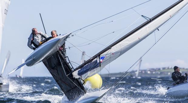 On side: Tim Neal and Bob Fry from Parkstone YC, England battle to stay upright at F18 World Championships at Ballyholme yesterday
