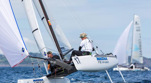 Set sail: Gunnar Larsen on way to victory in Worlds yesterday