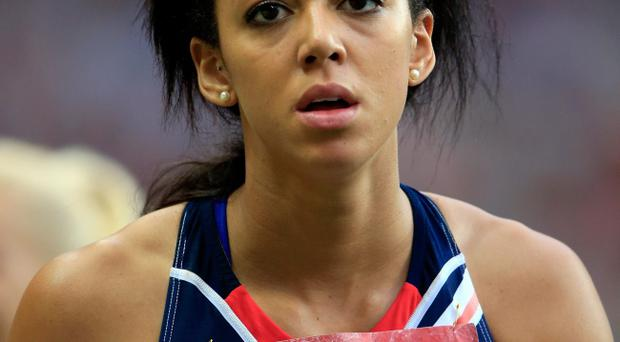 England's Katarina Johnson-Thompson will miss the 2014 Commonwealth Games in Glasgow because of a foot injury.