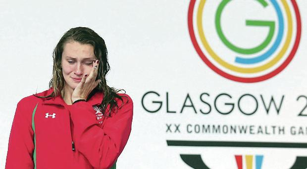 Crying game: Jazz Carlin fights tears after taking gold for Wales