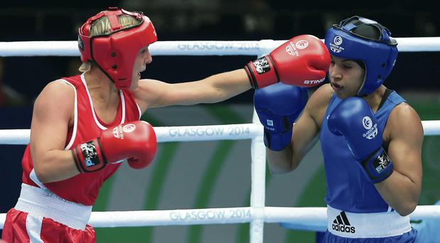 Take that: Alanna Audley-Murphy lands a punch against Dominica's Valerian Spicer in the Women's Light Quarter-final at the SECC yesterday
