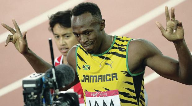 On track: Usain Bolt started his Glasgow 2014 campaign by helping Jamaica qualify for the final of the men's 4x100m relay