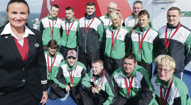 Medals of honour: Northern Ireland's 12 Commonwealth Games medallists are all smiles on their way home from Glasgow