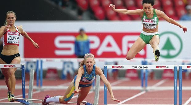 Leap of faith: Christine McMahon (right) avoids faller Hanna Ryzhykova on way to 400m hurdles semi-finals in Zurich yesterday