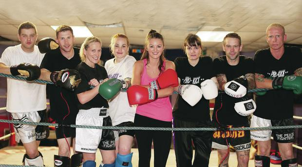 Golden gloves: from left to right, Alex Ciocoi, Johnny Smith, Cathy McAleer, Samantha Robb, Ursula Agnew, Gary Hamilton and Darren McMullen test the ropes with our girl Ali Gordon (pink vest, centre).