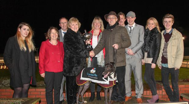 Winner: Owner of Free Falling, John Byrne, accepts the Robert Connolly trophy from Mrs Catherine Connolly