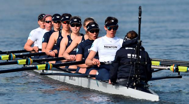 Full steam ahead: The Oxford women's boat race team row during a training session on the River Thames in Putney
