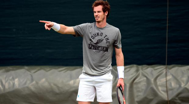 Pointing the way: Andy Murray got in a practice session at Wimbledon yesterday
