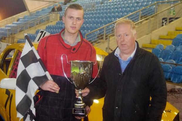 Winner: Steven McKane receives his trophy from event sponsor Thomas Moody
