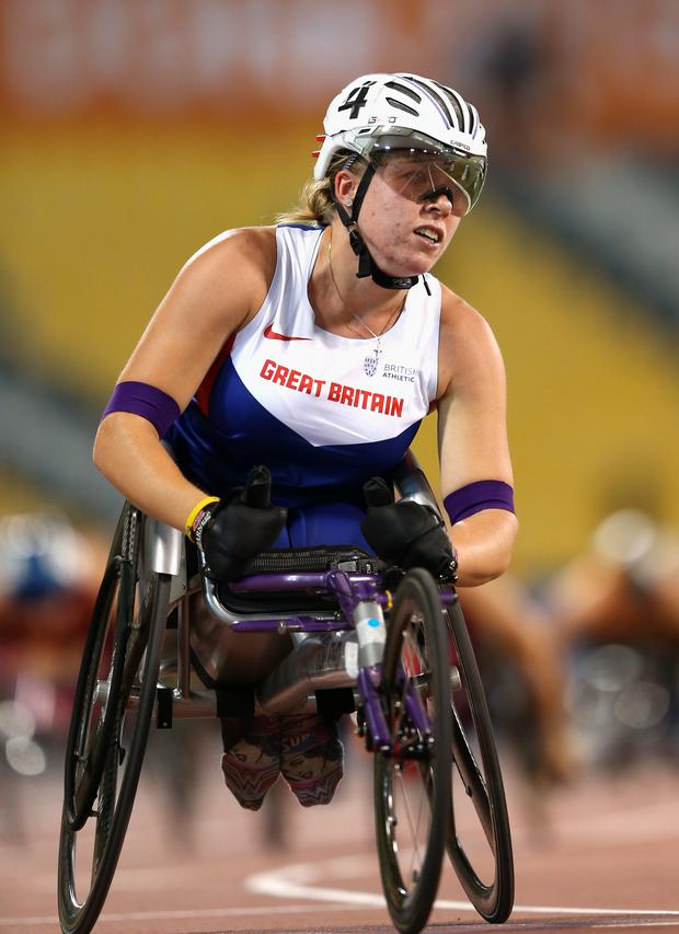 DOHA, QATAR - OCTOBER 28: Hannah Cockroft of Great Britain wins the women's 800m T34 final during the Evening Session on Day Seven of the IPC Athletics World Championships at Suhaim Bin Hamad Stadium on October 28, 2015 in Doha, Qatar. (Photo by Warren Little/Getty Images)