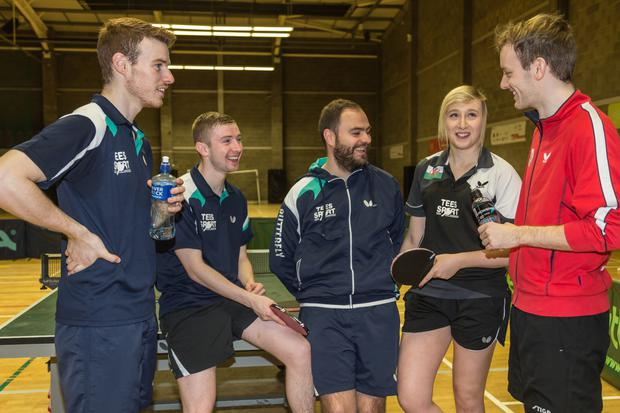 Top table: (from left) Gavin Maguire, Ashley Robinson (Ireland team), Ulster High Performance Coach John Murphy, Charlotte Carey (Welsh number one) and Dan O'Connell (Wales) take a break from practice yesterday at Lisburn Racquets Club